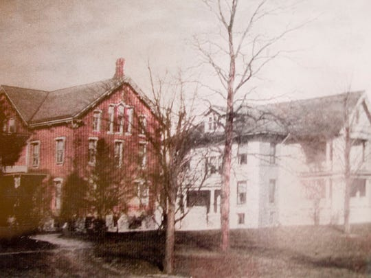 A historic photo of the Lindenwald Haus. The inn was once two separate houses. Both built of brick, the later house (circa 1920) is shown painted white, the earlier (circa 1877) is shown with the brick unpainted.