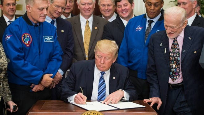 President Donald Trump on Friday signed an executive order to reestablish the National Space Council, alongside members of Congress, NASA and commercial space companies in the Roosevelt Room of the White House. Vice President Mike Pence, who will chair the council, will visit Kennedy Space Center next week.