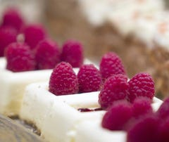 Lemon-raspberry cheesecakes and carrot cake defy dieters at the dessert station at the Wicked Spoon.
