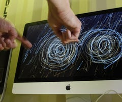 A South by Southwest Interactive attendee samples Leap Motion's 3D motion control.