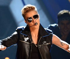 "Justin Bieber performs onstage during the 2013 Billboard Music Awards on May 19. Bieber reached 40M Twitter followers Tuesday and teased his new single ""Heartbreaker."""