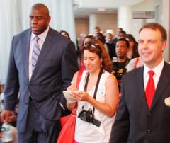 "Earvin ""Magic"" Johnson, left, talks with Barb DeLollis and hotel general manager Steve Cowan  at the iconic Washington Hilton hotel on May 25, 2010. Johnson is part of the ownership group that bought and renovated the hotel."