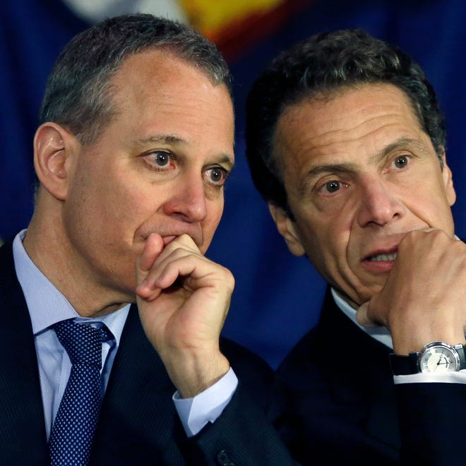 New York Gov. Andrew Cuomo, right, and New York Attorney General Eric Schneiderman talk during an Albany news conference in 2013.