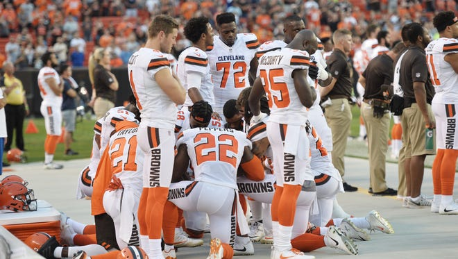 Members of the Cleveland Browns kneel during the national anthem before a game against the New York Giants at FirstEnergy Stadium.