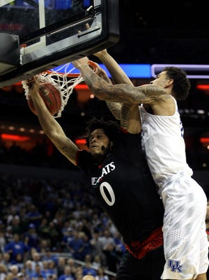Kentucky's Willie Cauley-Stein jams one over top of Cincinnati's Quadri Moore. March 21, 2015