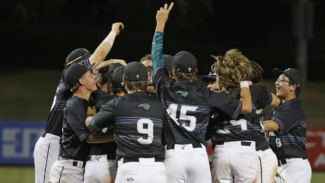 Phoenix Christian celebrates winning the 2A baseball State Championship game over San Tan Foothills in the tenth inning at Tempe Diablo Stadium in Tempe, Ariz. on May 14, 2018.