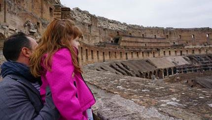"""Lizzy looking out over the Coliseum from the third tier. """"Where are the lions?"""" she asked the guide."""