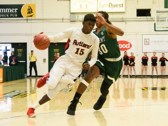 Rutland's Noah Tyson (15) drives to the hoop past St.