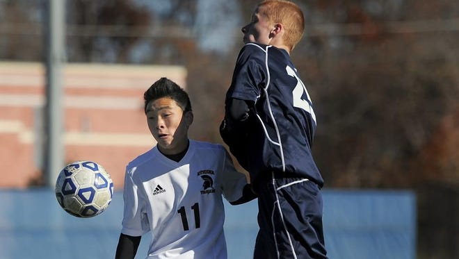 Ryan Lindeman, left, leads Greece Athena with six goals and six assists. The Trojans are the new No. 1 in the Democrat and Chronicle's large-school coaches poll.