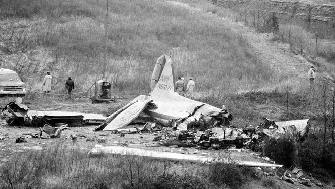This was the scene near Evansville's Dress Regional Airport, Dec. 14, 1977, following the crash Tuesday night of a chartered DC-3 airliner in which 29 people perished.  The entire University of Evansville basketball team was among the victims.  (AP Photo)