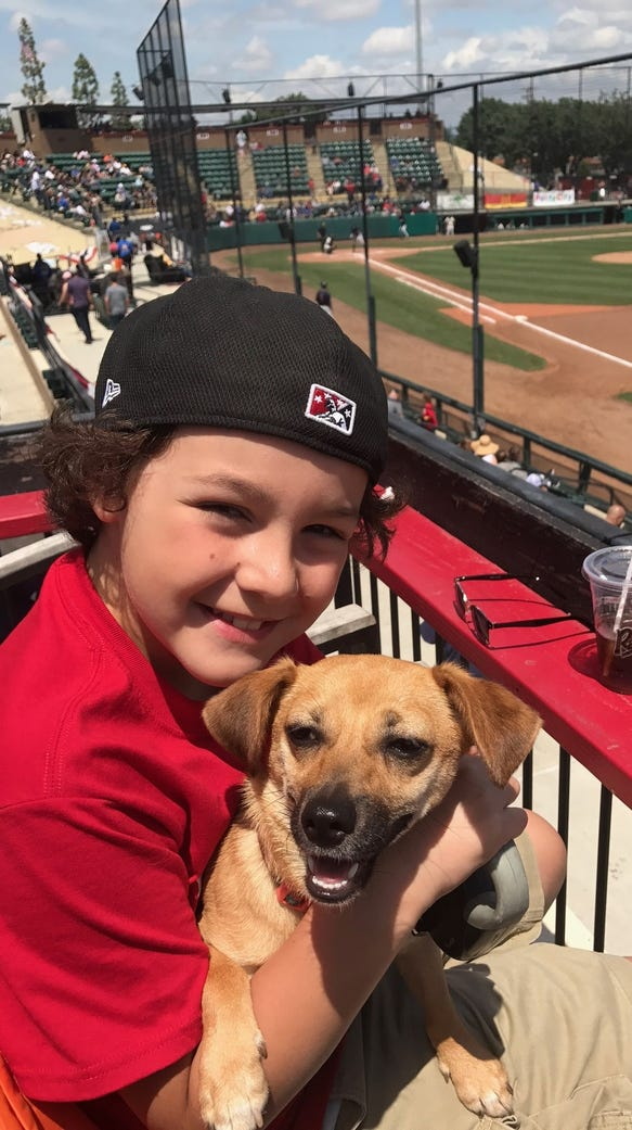 Caleb Brown and his dog Lily enjoy cheering on the