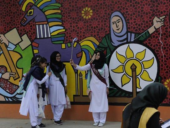 Women taking selfies. Islamabad, Pakistan.