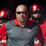 UNLV head coach Tony Sanchez stands in the tunnel with his players before taking the field against Boise State last season.