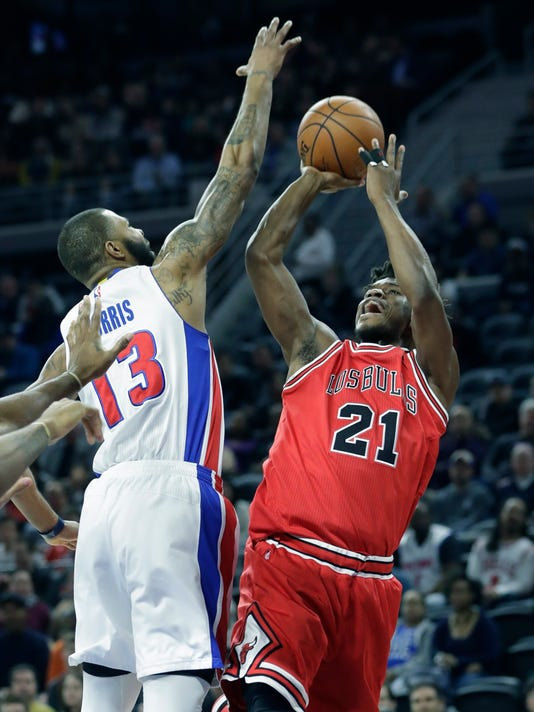 Chicago Bulls forward Jimmy Butler (21), defended by Detroit Pistons forward Marcus Morris (13), shoots during the first half of an NBA basketball game, Monday, March 6, 2017, in Auburn Hills, Mich. (AP Photo/Carlos Osorio)