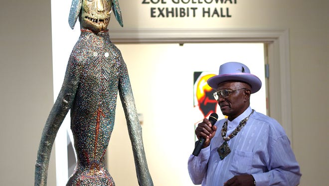 """O.L. Samuels and """"Godzilla"""" in the Sara May Love Gallery at the Gadsden Arts Center & Museum, 2009"""