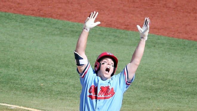 Catcher Henri Lartigue celebrates a game-winning hit against Auburn.