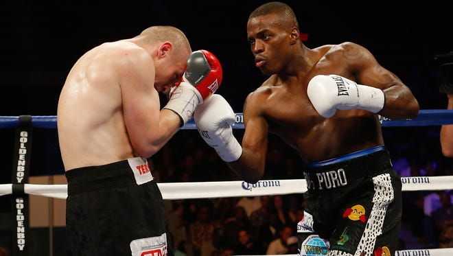 Peter Quillin, right, lands a right hand on Lukas Konecny (white gloves) and Lukas Konecny during their bout in April 2014 in Washington. Quillin won by TKO, but hasn't fought since.