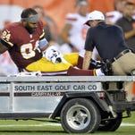 Washington Redskins tight end Niles Paul (84) leaves an Aug. 13 game in the first quarter after an injury during an NFL preseason football game against the Cleveland Browns in Cleveland. The games don't count. That makes the pain from major preseason injuries even more, well, painful.