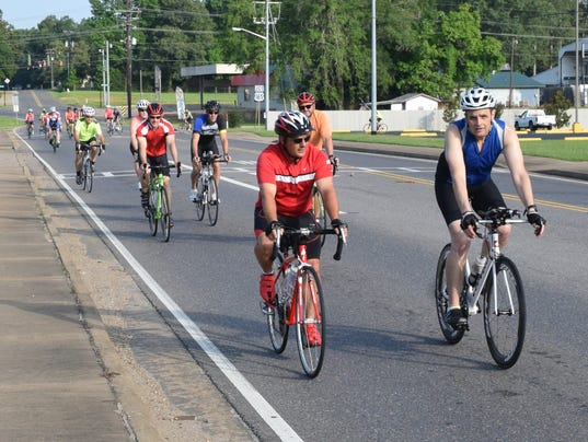 Jonathan Tassin (left), who is riding with Dale Winegeart, started cycling this year to get in shape. Tassin likes the social aspect of riding and that he can do it with his father Bert Tassin and brother B.J. Tassin.