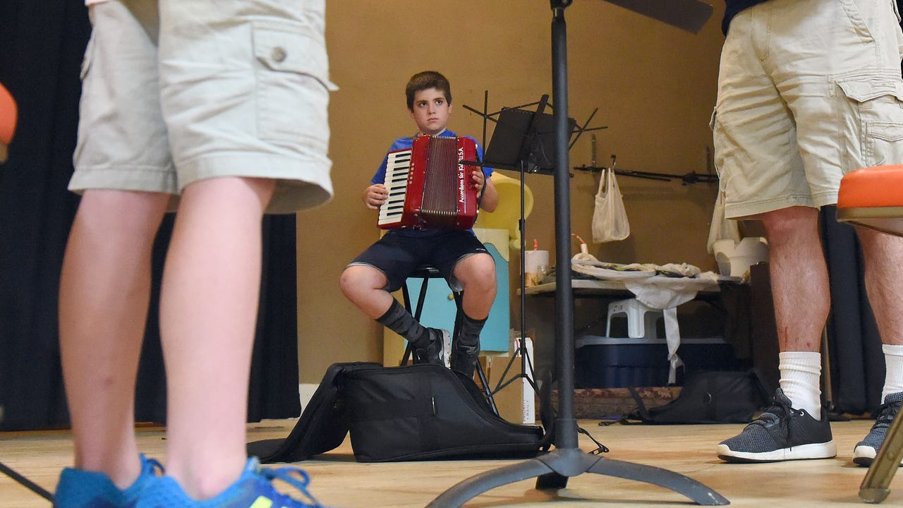 Camp participants have the opportunity to learn to play the accordion during Grace Christian School's fine arts summer camp in Staunton, Va.