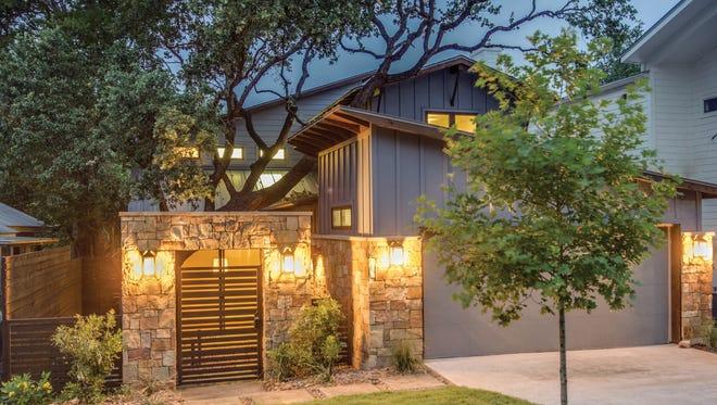 A stone-covered gateway opens up to a terrific private courtyard.