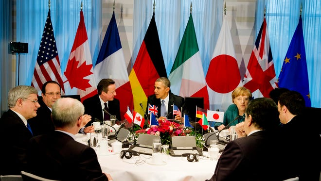 President Barack Obama, center rear,  gathered with G7 world leaders clockwise from center left, European Council president Herman Van Rompuy, Canadian Prime Minister Stephen Harper, French President Francois Hollande, British Prime Minister David Cameron, US President Barack Obama, German Chancellor Angela Merkel, Japanese Prime Minister Shinzo Abe, Italian Prime Minister Matteo Renzi and European Commission president Jose Manuel Barroso, in The Hague, Netherlands, Monday March 24, 2014, in the sidelines of the Nuclear security Summit. In a day of delicate diplomacy he sought to rally the international community Monday around efforts to isolate Russia following its incursion into Ukraine. Nuclear terrorism was the official topic as Obama and other world leaders streamed in to a convention center in The Hague for a two-day Nuclear Security Summit. But the real focus was on a hurriedly scheduled meeting of the Group of Seven industrialized economies to address the crisis in Ukraine on the sidelines of the nuclear summit.