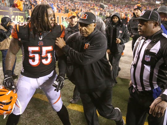 Cincinnati Bengals outside linebacker Vontaze Burfict (55) is restrained by Cincinnati Bengals head coach Marvin Lewis as he gestures toward an official at the conclusion of the NFL AFC wild-card game between the Pittsburgh Steelers and the Cincinnati Bengals, Saturday, Jan. 9, 2016, at Paul Brown Stadium in Cincinnati. The Steelers defeated the Bengals 18-16.