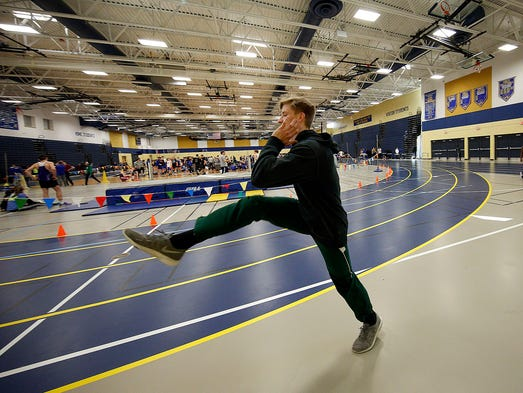 Wauwatosa West's Ean Haller warms up before the start
