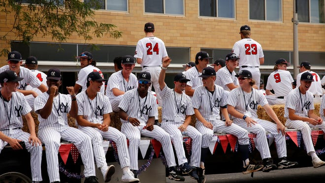 Members of the East Cobb Yankees ride on a float during last year's Connie Mack World Series Parade in downtown Farmington. This year's event takes place Thursday morning.