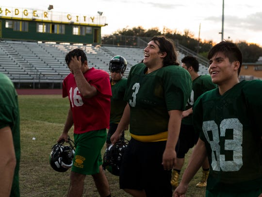 Bishop's Skyler Garza (center) laughs with teammates