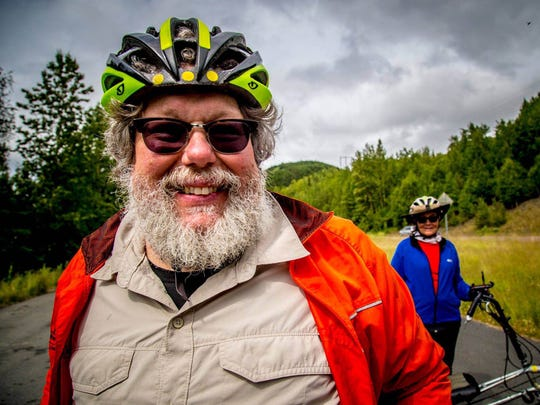 Chris Kegel (left) with his wife, Mary Hanley-Kegel, while bicycling in Alaska in June.