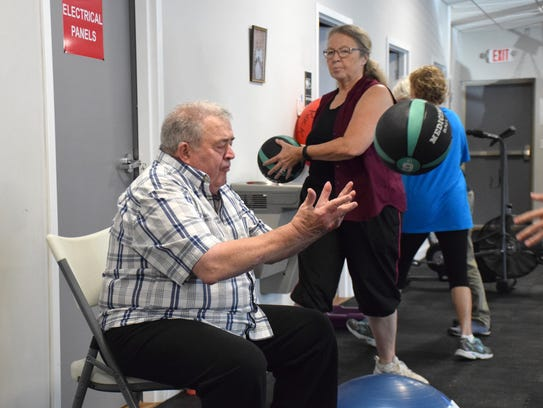 """Participant Pete Adams tosses a ball with a """"cornerman"""""""