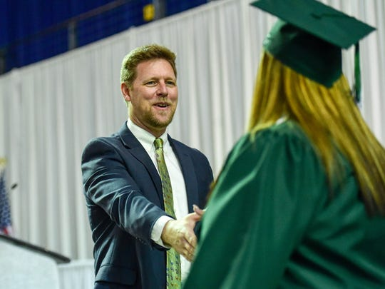 Superintendent Thomas Ahart congratulates a graduate on Saturday, May 28, 2016, during the North High School graduation at the Knapp Center at Drake University in Des Moines.