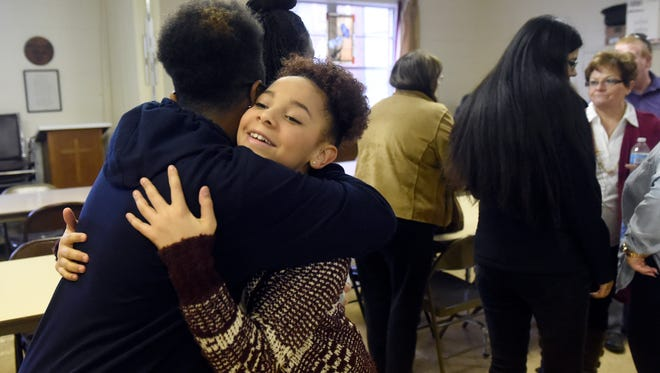 Ariel Edwards, left, gives a hug to her friend Carly Roach, the sister of missing Aleah Beckerle, during a birthday party and service for the girl who turns 20 this week at St. Lucas United Church of Christ in Evansville Saturday.  About 50 people attended the event for Aleah who was reported missing July 17.