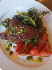 Sirloin with chimichurri alongside grilled watermelon