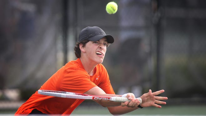 MTCS's Thomas Goodwyn returns a ball during a doubles semifinals match in the CLass A/AA state tournament at Old Fort Park. Goodwyn's partner was Will Reeves.
