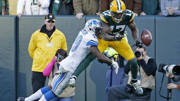 Detroit Lions' Crezdon Butler, a former Asheville High star, breaks up a two-point conversion intended for Green Bay Packers' Davante Adams last season in Green Bay, Wis. The Lions won 18-16.