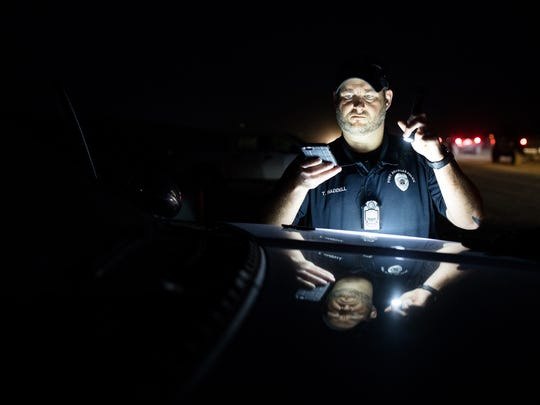 Port Aransas Police Officer Travis Waddell takes a