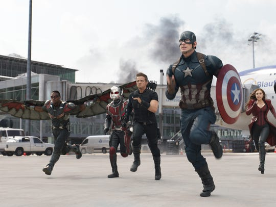 Ant-Man (second from left, Paul Rudd) rushes into battle