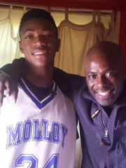 """Brandon Randolph and Russ Smith Sr. pose for a photo during the filming of the trailer for """"Underrated."""""""