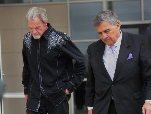 Colts owner Jim Irsay and attorney James Voyles leave the Hamilton County Sheriff's Office and Adult Detention center in Noblesville  Monday March 17, 2014, after Irsay's arrest on suspicion of driving under the influence and drug possession.