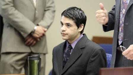Christian Alberto Martinez sits at the defendant's table during his capital murder trial in 2014. He was convicted of capital murder of multiple persons and sentenced to life in prison in connection with the 2011 stabbing deaths of Amalia Flores, 58, and her daughter Jovana Flores, 20.