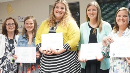 The Wausau School Board honored Taylor Utecht, Nicole Fidler, Joy Frystak and Megan Gast for graduating from teacher academies.