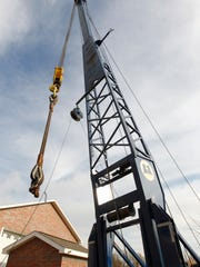 A crane lifts piping over a Waukesha well during an emergency repair in December 2018. Waukeha's plan to pump Lake Michigan water into the city could face a costly delay if a key component of it is not approved by New Berlin officials who say the proposal is not in line with city zoning code.