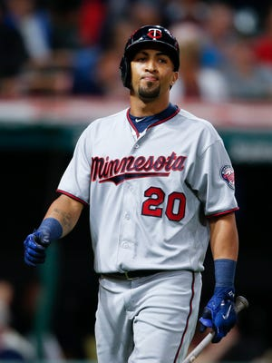 Minnesota Twins' Eddie Rosario reacts after being struck out by Cleveland Indians starting pitcher Cody Allen during the ninth inning in a baseball game, Wednesday, Sept. 27, in Cleveland. The Indians won 4-2.