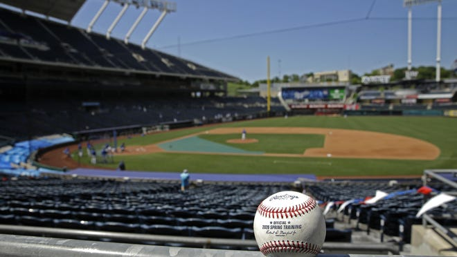 A foul ball rests in empty stands during Kansas City Royals' baseball practice at Kauffman Stadium on Thursday, July 9, 2020, in Kansas City, Mo.