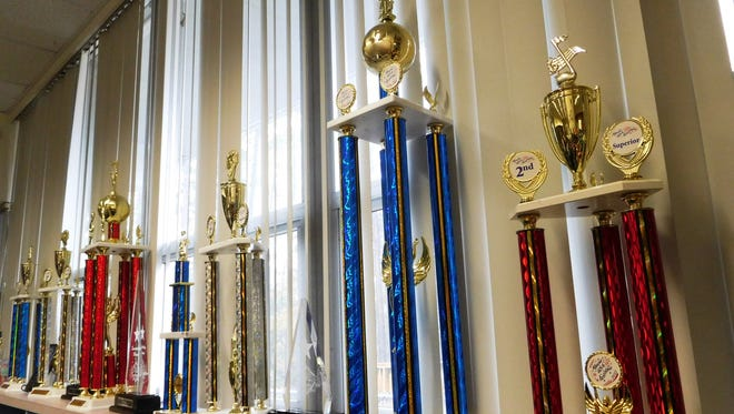 Choral trophies from past festivals on display in the music room