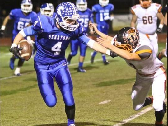 Asa Carter (4) plays football for Carson High School.