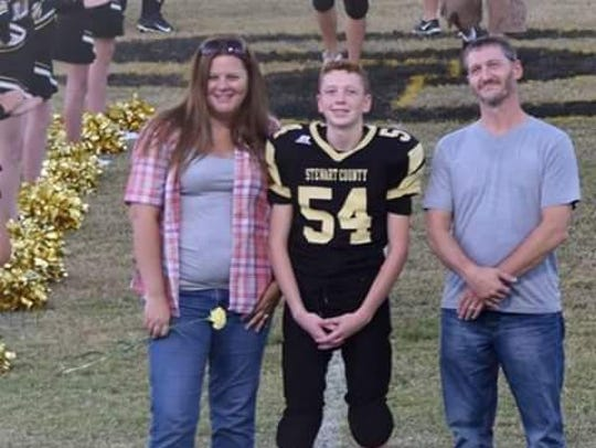 Jamie Chandler, left, with her family. Her son, center,