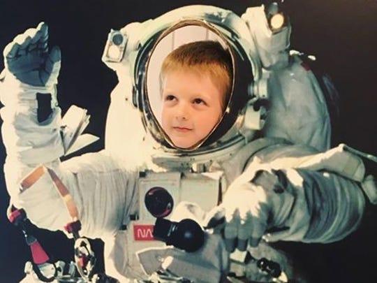 Jaxsen Palmer poses as an astronaut during a visit